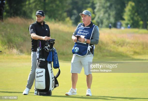 Tyrrell Hatton of England in is pictured with his caddie Mick Donaghy during the Pro Am event prior to the start of the Aberdeen Standard Investments...