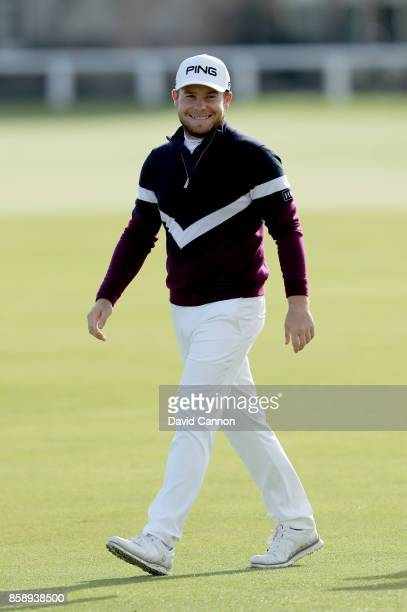 Tyrrell Hatton of England is all smiles after holing his fourth shot on the first hole during the final round of the 2017 Alfred Dunhill Links...