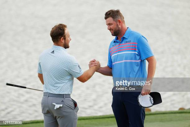 Tyrrell Hatton of England is congratulated during the final round of the Arnold Palmer Invitational Presented by MasterCard at the Bay Hill Club and...