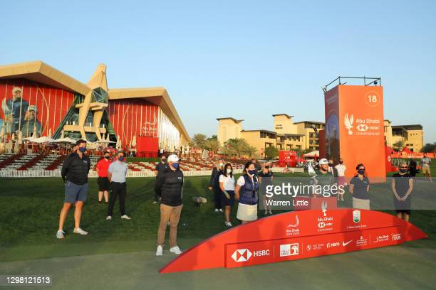 Tyrrell Hatton of England is presented with the trophy during Day 4 of the Abu Dhabi HSBC Championship at Abu Dhabi Golf Club on January 24, 2021 in...
