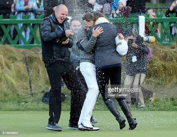 Tyrrell Hatton of England is showered by champagne on the 18th green after winning the Alfred Dunhill Links Championship at The Old Course on October...