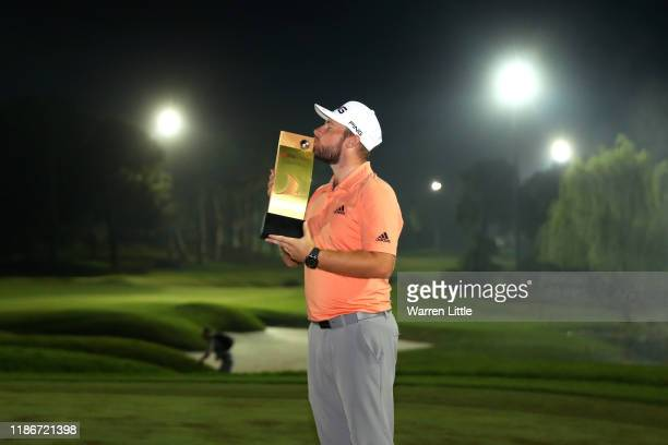 Tyrrell Hatton of England kisses the trophy as he poses for a photo after winning the 2019 Turkish Airlines Open in a playoff on Day Four of the...
