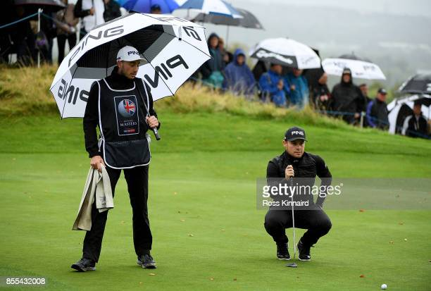 Tyrell Hatton of England lines up a putt on the 16th hole during day two of the British Masters at Close House Golf Club on September 29 2017 in...