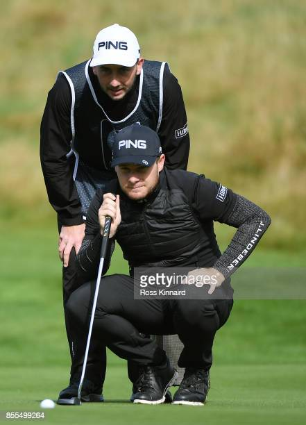 Tyrell Hatton of England lines up a putt on the 9th hole during day two of the British Masters at Close House Golf Club on September 29 2017 in...