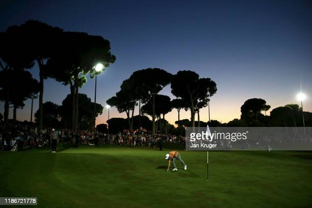 Tyrrell Hatton of England marks his ball on the eighteenth green in the playoff during Day Four of the Turkish Airlines Open at The Montgomerie Maxx...