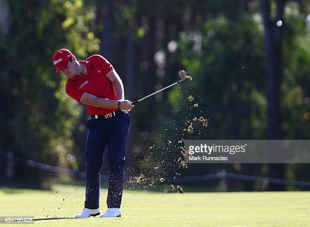 Tyrrell Hatton of England plays a chip shot to the second hole and holes out for and eagle during the first round of the Turkish Airlines Open at The...