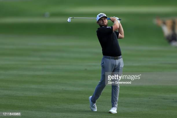 Tyrrell Hatton of England plays a shot during a practice round prior to The PLAYERS Championship on The Stadium Course at TPC Sawgrass on March 11...