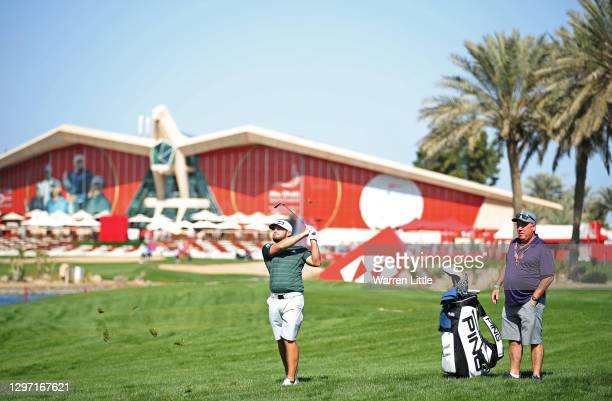 Tyrrell Hatton of England plays a shot during practice ahead of the Abu Dhabi HSBC Championship at Abu Dhabi Golf Club on January 19, 2021 in Abu...