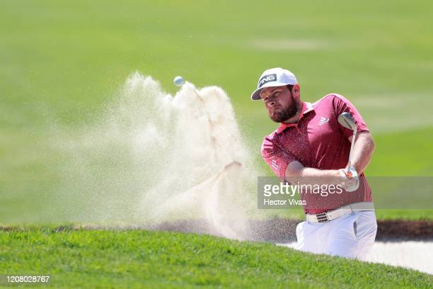 Tyrrell Hatton of England plays a shot from a bunker on the first hole during the third round of the World Golf Championships Mexico Championship at...