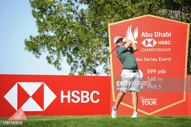 Tyrrell Hatton of England plays a shot from the 2nd tee during practice ahead of the Abu Dhabi HSBC Championship at Abu Dhabi Golf Club on January...