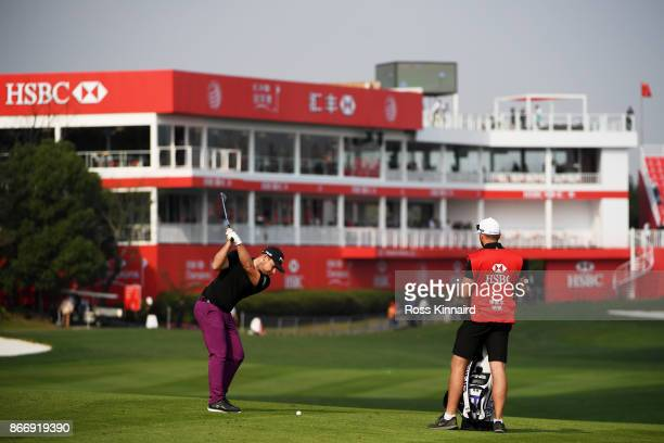 Tyrell Hatton of England plays a shot on the 18th hole during the second round of the WGC HSBC Champions at Sheshan International Golf Club on...