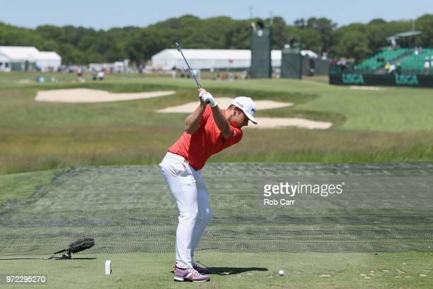 Tyrrell Hatton of England plays a tee shot during a practice round prior to the 2018 US Open at Shinnecock Hills Golf Club on June 12 2018 in...
