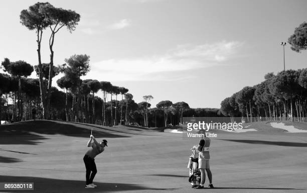 Tyrrell Hatton of England plays his second shot into the 12th green during the first round of the Turkish Airlines Open at the Regnum Carya Golf Spa...