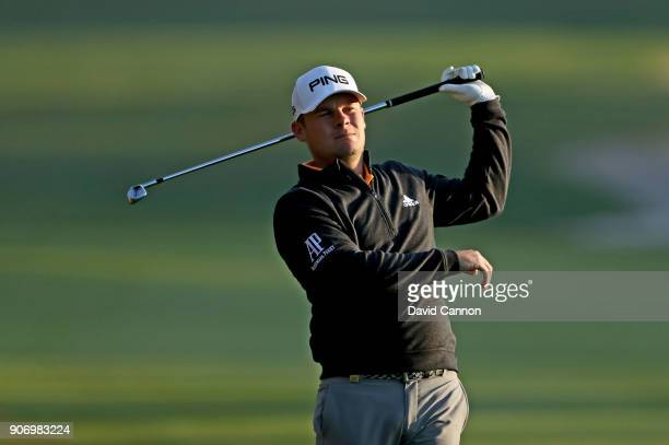 Tyrrell Hatton of England plays his second shot on the 10th hole during the second round of the 2018 Abu Dhabi HSBC Golf Championship at the Abu...