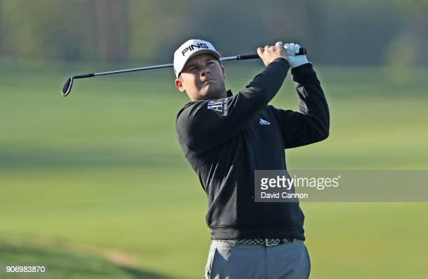 Tyrrell Hatton of England plays his second shot on the 13th hole during the second round of the 2018 Abu Dhabi HSBC Golf Championship at the Abu...