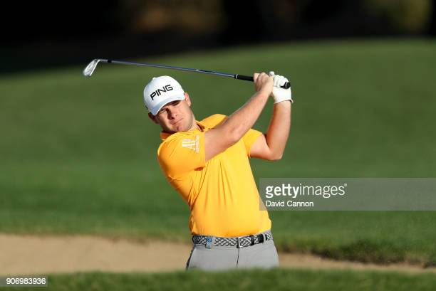 Tyrrell Hatton of England plays his second shot on the 14th hole during the second round of the 2018 Abu Dhabi HSBC Golf Championship at the Abu...