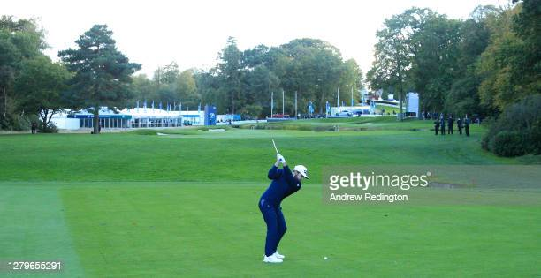 Tyrrell Hatton of England plays his second shot on the 18th hole during Day Four of the BMW PGA Championship at Wentworth Golf Club on October 11,...
