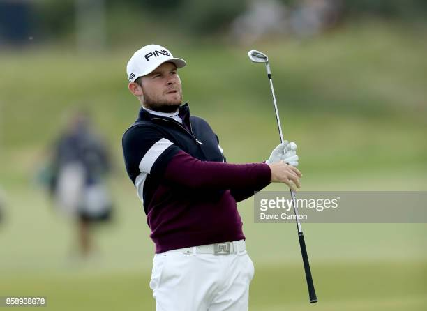 Tyrrell Hatton of England plays his second shot on the second hole during the final round of the 2017 Alfred Dunhill Links Championship on the Old...