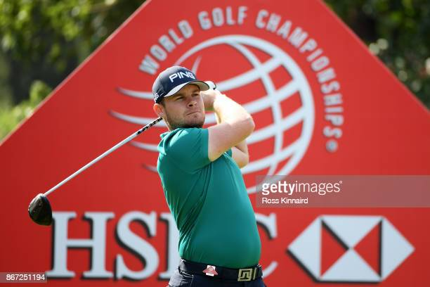 Tyrell Hatton of England plays his shot from the first tee during the third round of the WGC HSBC Champions at Sheshan International Golf Club on...