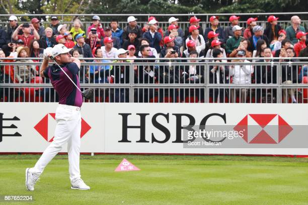 Tyrell Hatton of England plays his shot from the first tee during the final round of the WGC HSBC Champions at Sheshan International Golf Club on...