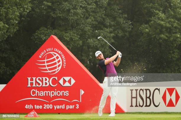 Tyrell Hatton of England plays his shot from the fourth tee during the final round of the WGC HSBC Champions at Sheshan International Golf Club on...