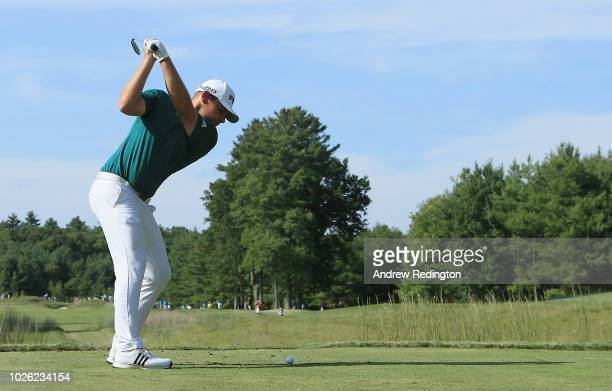 Tyrrell Hatton of England plays his shot from the tenth tee during round three of the Dell Technologies Championship at TPC Boston on September 2,...