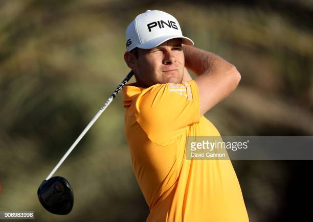 Tyrrell Hatton of England plays his tee shot on the 14th hole during the second round of the 2018 Abu Dhabi HSBC Golf Championship at the Abu Dhabi...