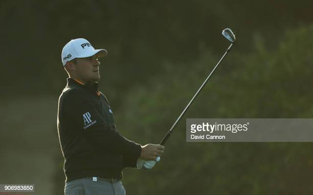 Tyrrell Hatton of England plays his third shot on the 10th hole during the second round of the 2018 Abu Dhabi HSBC Golf Championship at the Abu Dhabi...