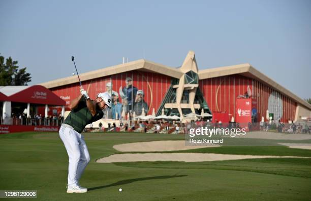 Tyrrell Hatton of England plays his third shot on the 18th hole during the final round of the Abu Dhabi HSBC Championship at Abu Dhabi Golf Club on...