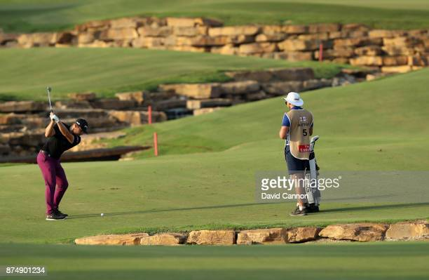 Tyrrell Hatton of England plays his third shot on the 18th hole during the first round of the DP World Tour Championship on the Earth Course at...