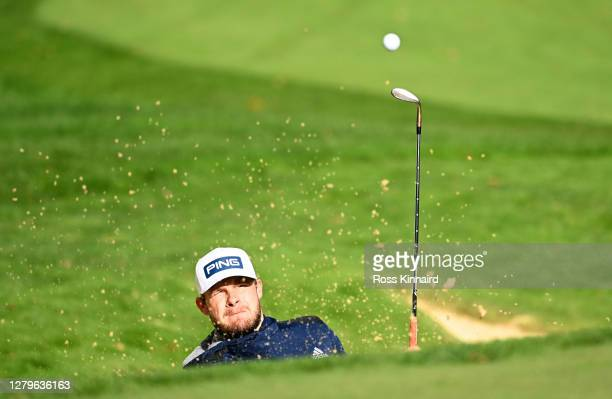 Tyrrell Hatton of England plays his third shot on the 7th hole during Day Four of the BMW PGA Championship at Wentworth Golf Club on October 11, 2020...
