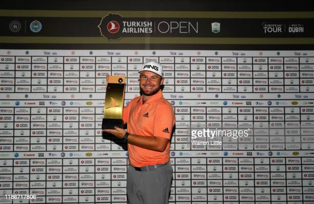 Tyrrell Hatton of England poses with the trophy after winning the 2019 Turkish Airlines Open in a playoff on Day Four of the Turkish Airlines Open at...