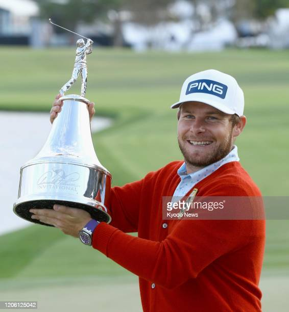 Tyrrell Hatton of England poses with the trophy after winning the Arnold Palmer Invitational golf tournament at Bay Hill Club and Lodge in Orlando...