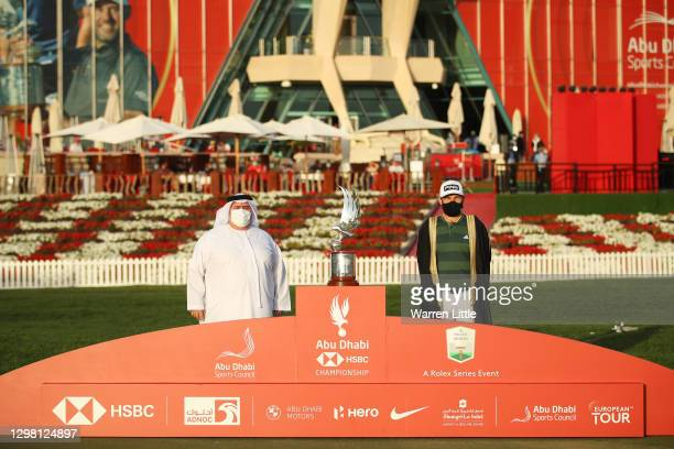 Tyrrell Hatton of England poses with the trophy following victory during Day 4 of the Abu Dhabi HSBC Championship at Abu Dhabi Golf Club on January...