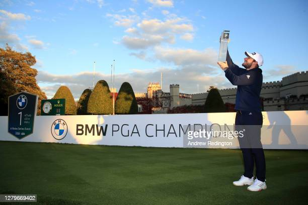 Tyrrell Hatton of England poses with the trophy following victory during Day Four of the BMW PGA Championship at Wentworth Golf Club on October 11,...
