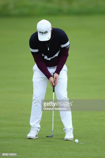Tyrrell Hatton of England putts in on the 18th to secure victory during the final round of the 2017 Alfred Dunhill Championship at The Old Course on...