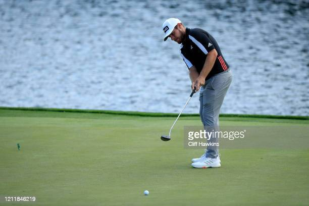 Tyrrell Hatton of England putts on the 18th green during a practice round prior to The PLAYERS Championship on The Stadium Course at TPC Sawgrass on...