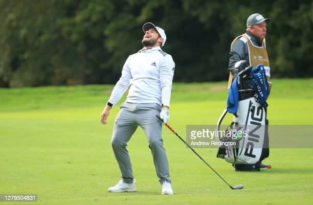 Tyrrell Hatton of England reacts after second shot on the 17th hole during Day Three of the BMW PGA Championship at Wentworth Golf Club on October...