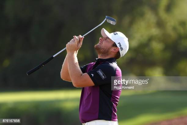 Tyrrell Hatton of England reacts on the 17th green during the final round of the DP World Tour Championship at Jumeirah Golf Estates on November 19...