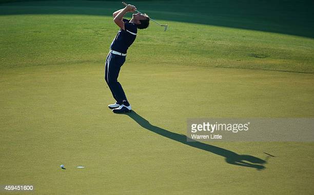 Tyrrell Hatton of England reacts to a missed putt on the 18th green during the third round of the DP World Tour Championship at Jumeirah Golf Estates...