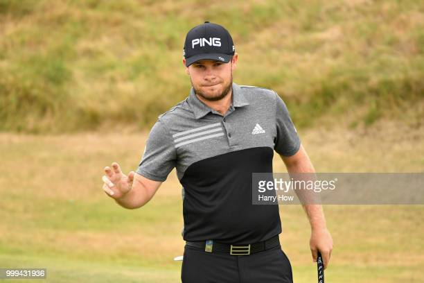 Tyrrell Hatton of England reacts to his birdie putt on hole one during day four of the Aberdeen Standard Investments Scottish Open at Gullane Golf...
