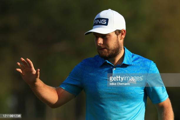 Tyrrell Hatton of England reacts to his putt on the 11th green during the first round of The PLAYERS Championship on The Stadium Course at TPC...