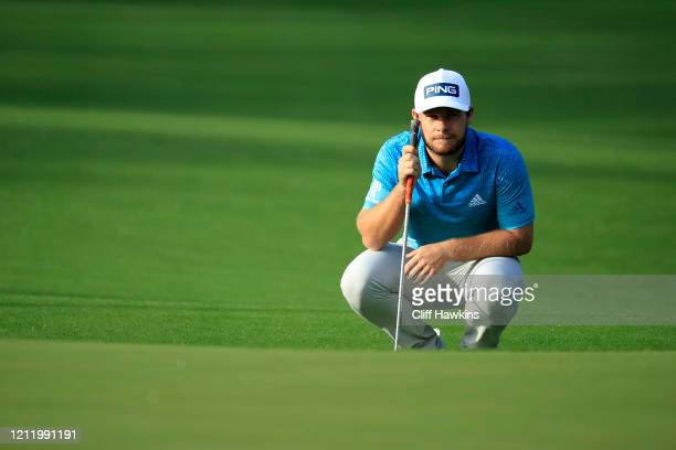 Tyrrell Hatton of England reads a putt on the 10th green during the first round of The PLAYERS Championship on The Stadium Course at TPC Sawgrass on...