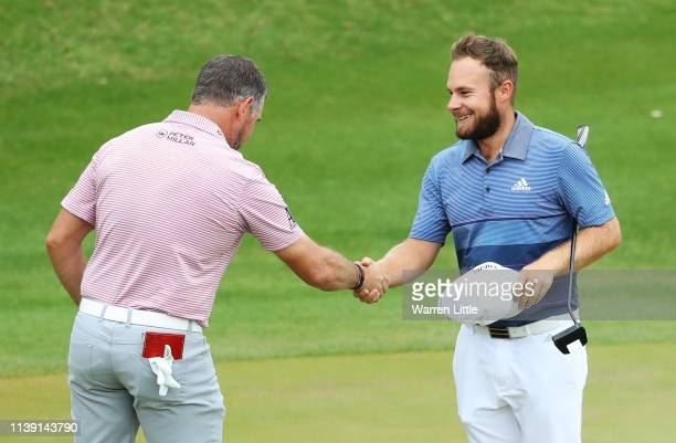 Tyrrell Hatton of England shakes hands with Lee Westwood of England after defeating him 31 during the third round of the World Golf ChampionshipsDell...