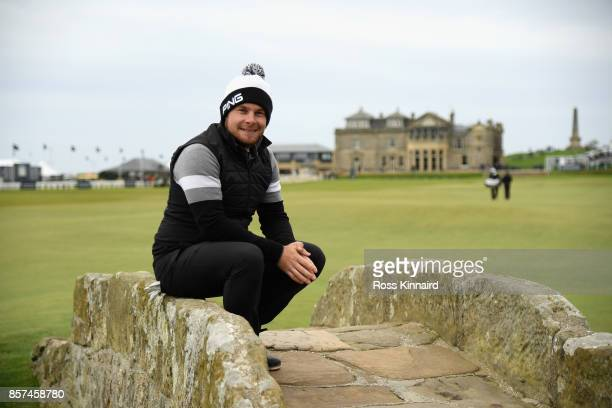 Tyrell Hatton of England sits on the Swilken bridge during practice prior to the 2017 Alfred Dunhill Links Championship at The Old Course on October...