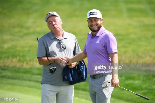 Tyrrell Hatton of England smiles alongside caddie Mick Donaghy during a practice round prior to the 2019 US Open at Pebble Beach Golf Links on June...