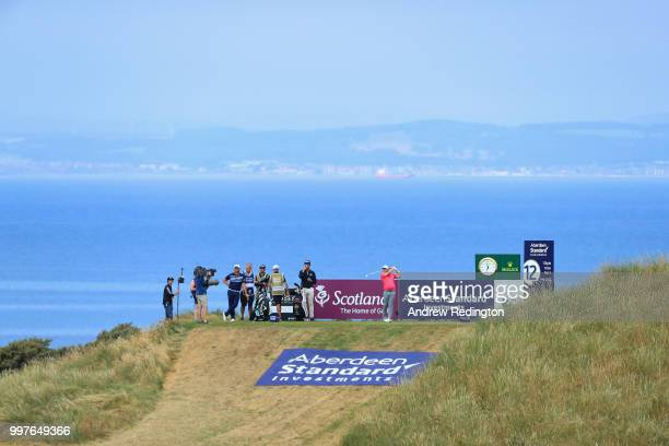 Tyrrell Hatton of England takes his tee shot on hole twelve during day two of the Aberdeen Standard Investments Scottish Open at Gullane Golf Course...