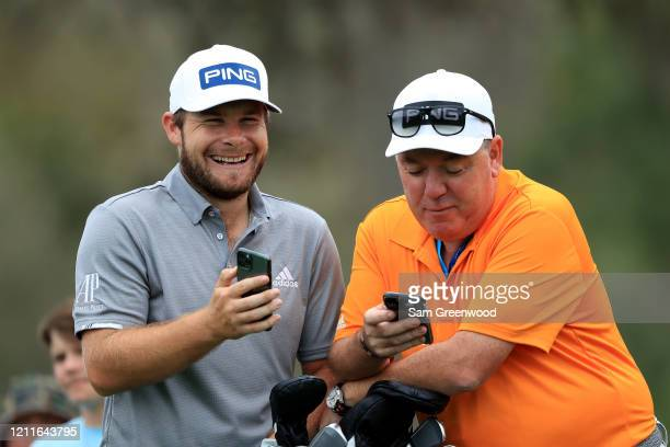 Tyrrell Hatton of England talks to caddie Mick Donaghy during a practice round prior to The PLAYERS Championship on The Stadium Course at TPC...