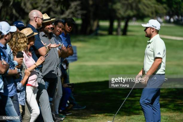 Tyrell Hatton of England talks to members of the gallery on the 16th hole during round three of the World Golf ChampionshipsMexico Championship at...