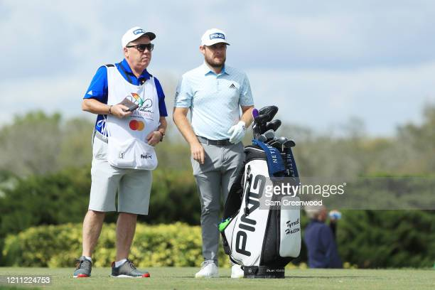 Tyrrell Hatton of England talks with his caddie Mick Donaghy during the final round of the Arnold Palmer Invitational Presented by MasterCard at the...